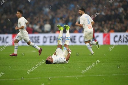 ONE. Marseille's Dimitri Payet reacts after a takle during the French League One soccer match between Marseille and Lyon at the Velodrome stadium in Marseille, southern France