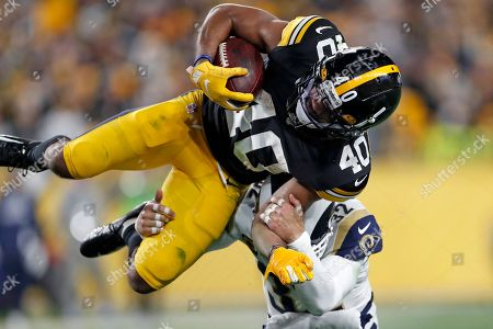 Los Angeles Rams free safety Eric Weddle (32) tackles Pittsburgh Steelers running back Tony Brooks-James (40) during the second half of an NFL football game in Pittsburgh