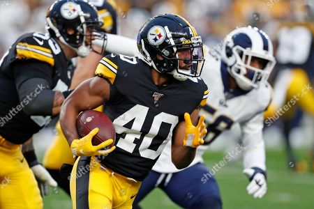 Pittsburgh Steelers running back Tony Brooks-James (40) carries the ball during the first half of an NFL football game against the Los Angeles Rams in Pittsburgh