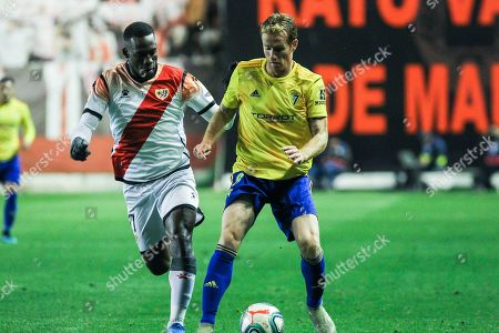 Luis Advincula, player of Rayo Vallecano from Peru,and Alex Fernandez, player of Cadiz CF from Spain