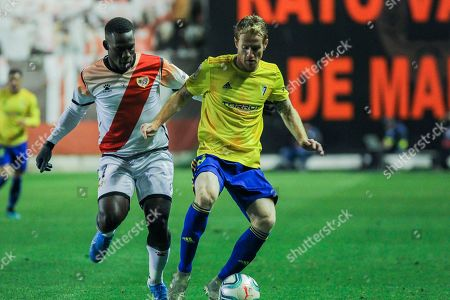 Stock Photo of Luis Advincula, player of Rayo Vallecano from Peru, and Alex Fernandez, player of Cadiz CF from Spain, fight for the ball