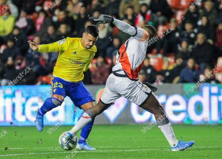 Nano Mesa, player of Cadiz CF from Spain, and Luis Advincula, player of Rayo Vallecano from Peru, fight for the ball