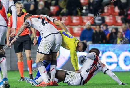 Nano Mesa, player of Cadiz CF from Spain, Esteban Saveljich, player of Rayo Vallecano from Montenegro, and Luis Advincula, player of Rayo Vallecano from Peru, fight for the ball