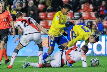 Nano Mesa, player of Cadiz CF from Spain, Choco Lozano, player of Cadiz CF from Honduras, Esteban Saveljich, player of Rayo Vallecano from Montenegro, and Luis Advincula, player of Rayo Vallecano from Peru, fight for the ball