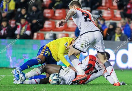 Stock Picture of Nano Mesa, player of Cadiz CF from Spain, and Luis Advincula, player of Rayo Vallecano from Peru, fight for the ball