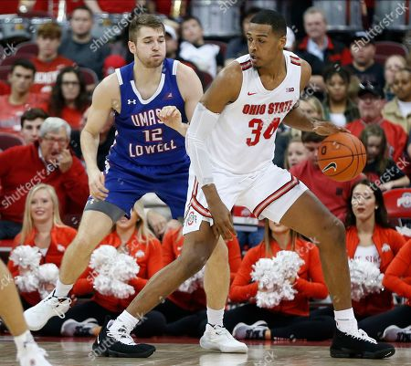 Ohio State's Kaleb Wesson, right, posts up against UMass-Lowell's Josh Gantz during the first half of an NCAA college basketball game, in Columbus, Ohio