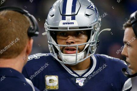 Dallas Cowboys' Dak Prescott (4) talks with head coach Jason Garrett and offensive coordinator Kellen Moore, right, in the second half of an NFL football game against the Minnesota Vikings in Arlington, Texas