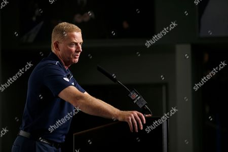 Dallas Cowboys head coach Jason Garrett responds to questions during a news conference after an NFL football game against the Minnesota Vikings in Arlington, Texas