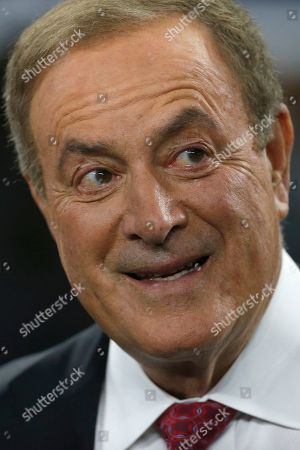 Al Michaels, play-by-play voice for NBC's Sunday Night Football, looks on from the field before the game between the Dallas Cowboys and Minnesota Vikings in an NFL football game in Arlington, Texas