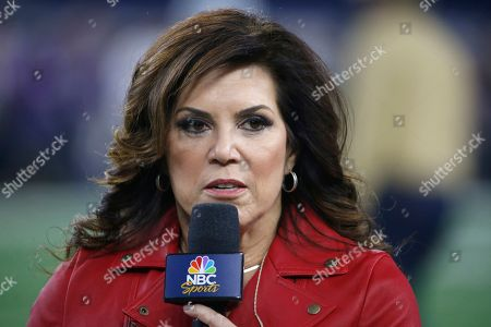 Michele Tafoya, sideline reporter for NBC's Sunday Night Football, looks on from the field before the game between the Dallas Cowboys and Minnesota Vikings in an NFL football game in Arlington, Texas