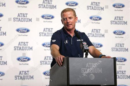 Stock Photo of Dallas Cowboys head coach Jason Garrett speaks following the game between the Dallas Cowboys and Minnesota Vikings in an NFL football game in Arlington, Texas