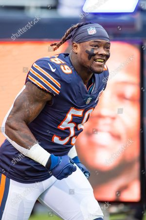 Chicago, Illinois, U.S. - Bears #59 Danny Trevathan runs on to the field before the NFL Game between the Detroit Lions and Chicago Bears at Soldier Field in Chicago, IL. Photographer: Mike Wulf