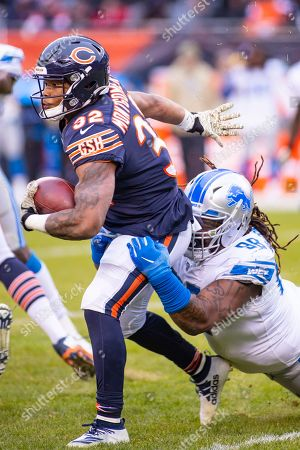 Chicago, Illinois, U.S. - Bears #32 David Montgomery and Lions #98 Damon Harrison Sr. in action during the NFL Game between the Detroit Lions and Chicago Bears at Soldier Field in Chicago, IL. Photographer: Mike Wulf
