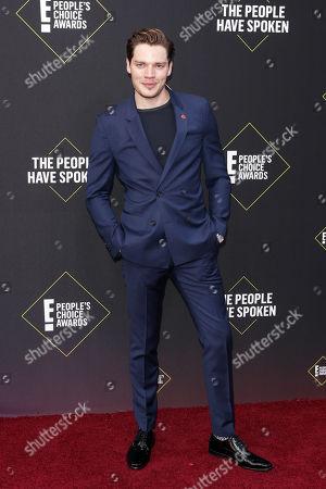 Dominic Sherwood arrives for the 2019 People's Choice Awards at the Barker Hangar in Santa Monica, California, USA, 10 November 2019.
