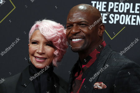 Terry Crews (R) and his wife Rebecca (L) arrive for the 2019 People's Choice Awards at the Barker Hangar in Santa Monica, California, USA, 10 November 2019.