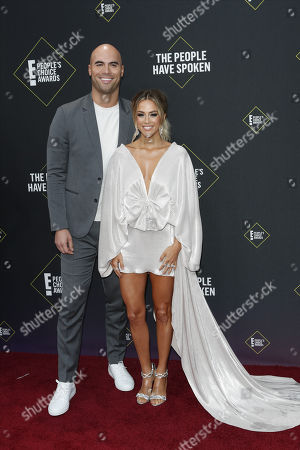 Mike Caussin (L) and Jana Kramer (R) arrive for the 2019 People's Choice Awards at the Barker Hangar in Santa Monica, California, USA, 10 November 2019.