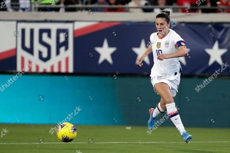 United States forward Carli Lloyd moves the ball against Costa Rica during the first half of an international friendly soccer match, in Jacksonville, Fla
