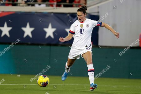 United States forward Carli Lloyd shoots and scores a goal against the Costa Rica during the first half of an international friendly soccer match, in Jacksonville, Fla