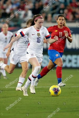 United States midfielder Rose Lavelle (16) moves the ball past Costa Rica midfielder Raquel Rodriguez (11) during the first half of an international friendly soccer match, in Jacksonville, Fla