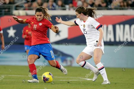 Costa Rica midfielder Raquel Rodriguez (11) moves the ball past United States midfielder Andi Sullivan (25) during the second half of an international friendly soccer match, in Jacksonville, Fla