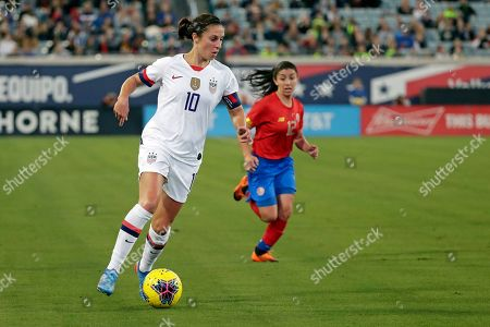 United States forward Carli Lloyd (10) moves the ball past Costa Rica defender Lixy Rodriguez (12) during the first half of an international friendly soccer match, in Jacksonville, Fla