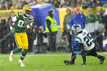 Stock Picture of Green Bay Packers wide receiver Geronimo Allison #81 runs past Carolina Panthers strong safety Eric Reid #25 during the NFL Football game between the Carolina Panthers and the Green Bay Packers at Lambeau Field in Green Bay, WI. Packers defeated the Panthers 24-16