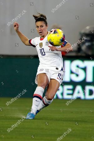 Stock Image of U.S. forward Carli Lloyd shoots and scores a goal against Costa Rica during the first half of an international friendly soccer match, in Jacksonville, Fla