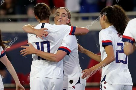 Stock Picture of Carli Lloyd, Morgan Brian, Christen Press. U.S. midfielder Morgan Brian, center, celebrates her goal against Costa Rica with forwards Carli Lloyd, left, and Christen Press, right, during the first half of an international friendly soccer match, in Jacksonville, Fla