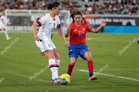 U.S. forward Carli Lloyd, left, works for possession against Costa Rica defender Lixy Rodriguez (12) during the first half of an international friendly soccer match, in Jacksonville, Fla