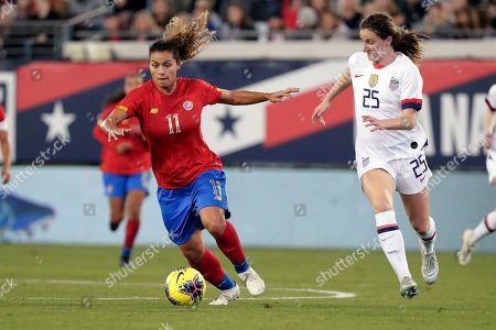 Costa Rica midfielder Raquel Rodriguez (11) moves the ball past U.S. midfielder Andi Sullivan (25) during the second half of an international friendly soccer match, in Jacksonville, Fla