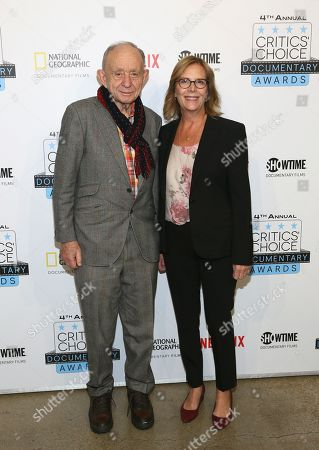 Frederick Wiseman, Chris Hegedus. D A Pennybaker Award recipient Frederick Wiseman is pictured with Chris Hegedus, wife of the late filmmaker for whom the Lifetime Achievement award has been renamed, during arrivals at the Fourth Annual Critics' Choice Documentary Awards in New York, N.Y