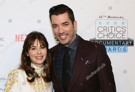 Jonathan Scott, Zooey Deschanel. Host, Jonathan Scott is pictured during arrivals with his girlfriend, actress Zooey Deschanel at the Fourth Annual Critics' Choice Documentary Awards in New York, N.Y