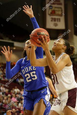 Texas A&M forward N'dea Jones (31) looks to shoot against Duke forward Jade Williams (25) during an NCAA women's basketball game, in College Station, Texas