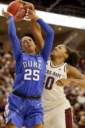 Texas A&M center Ciera Johnson (40) blocks a shot attempt by Duke forward Jade Williams (25) during an NCAA women's basketball game, in College Station, Texas