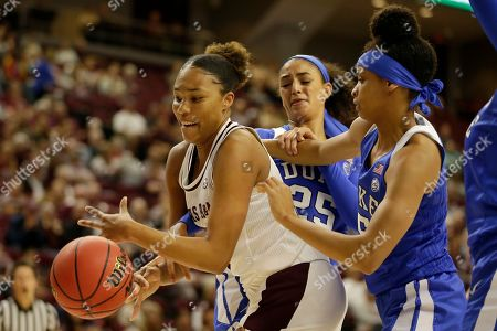 Texas A&M forward N'dea Jones (31) fights for a loose ball with Duke forward Jade Williams (25) and forward Leaonna Odom (5) during an NCAA women's basketball game, in College Station, Texas