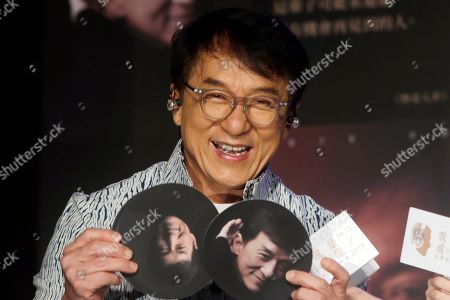 """Hong Kong actor and singer Jackie Chan shows photos during a promotional event announcing his new album """"I AM ME"""" in Taipei, Taiwan. A visit by Chan to Vietnam has been cancelled following complaints over his alleged pro-China stance on South China Sea sovereignty issues"""