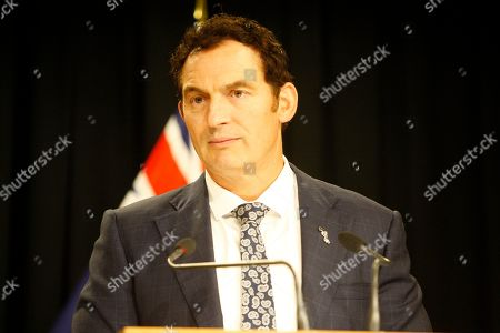 Police Minister Stuart Nash talks to reporters, in Wellington, New Zealand. New Zealand's government on Monday proposed legislation to ban certain criminals from being anywhere near guns even if they don't own them, a measure that politicians acknowledge has significant human rights implications
