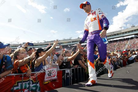 Stock Picture of Denny Hamlin greets fans during driver introductions prior to the NASCAR Cup Series auto race at ISM Raceway, in Avondale, Ariz