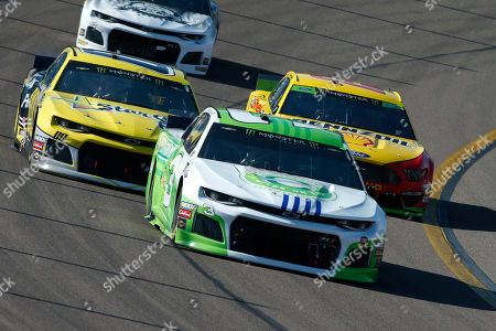 Austin Dillon (3), Landon Cassill (00) and Joey Logano (22) during the NASCAR Cup Series auto race at ISM Raceway, in Avondale, Ariz