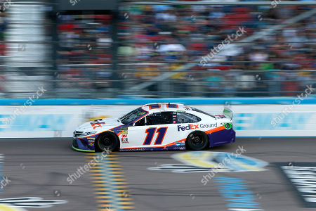 Denny Hamlin drives during the NASCAR Cup Series auto race at ISM Raceway, in Avondale, Ariz