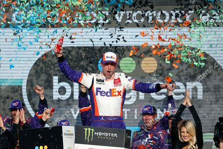 Denny Hamlin celebrates in victory lane after winning the NASCAR Cup Series auto race at ISM Raceway, in Avondale, Ariz