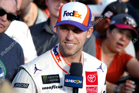 Denny Hamlin after winning the NASCAR Cup Series auto race at ISM Raceway, in Avondale, Ariz