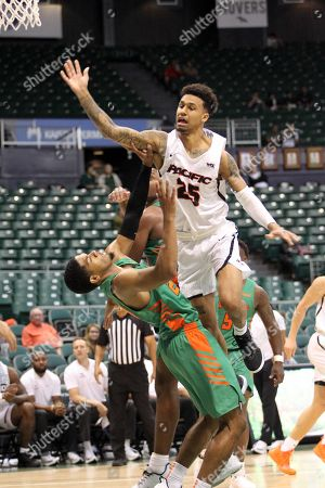 Pacific Tigers guard Justin Moore #25 goes over Florida A&M Rattlers guard Brendon Myles #20 for a lay up during a game between the Florida A&M Rattlers and the Pacific Tigers at the Stan Sheriff Center in Honolulu, HI - Michael Sullivan/CSM