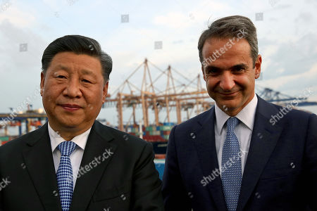Greek Prime Minister Kyriakos Mitsotakis (R) and Chinese President Xi Jinping (L) visit the cargo terminal of Chinese company Cosco in the port of Piraeus, Greece, 11 November 2019. Chinese President Xi is on a two-day official visit to Greece.