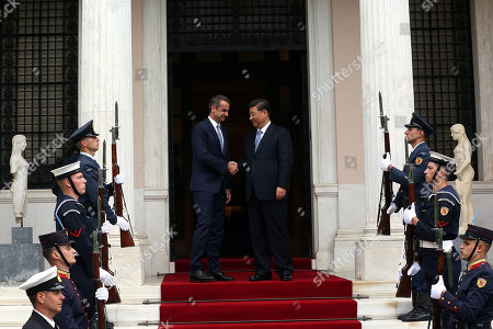 Greek Prime Minister Kyriakos Mitsotakis (C-L) welcomes Chinese President Xi Jinping (C-R) at the Maximos Mansion in Athens, Greece, 11 November 2019. Xi Jinping is on an official three-day visit to Greece.