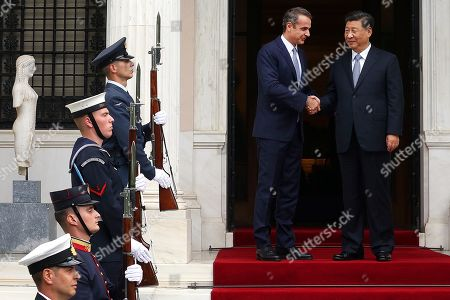 Greek Prime Minister Kyriakos Mitsotakis (2-R) welcomes Chinese President Xi Jinping (R) at the Maximos Mansion in Athens, Greece, 11 November 2019. Xi Jinping is on an official three-day visit to Greece.