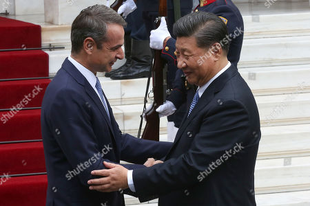 Greek Prime Minister Kyriakos Mitsotakis (L) welcomes Chinese President Xi Jinping (R) at the Maximos Mansion in Athens, Greece, 11 November 2019. Xi Jinping is on an official three-day visit to Greece.