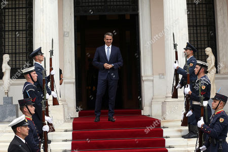 Greek Prime Minister Kyriakos Mitsotakis (C) waits for Chinese President Xi Jinping (not pictured) at the Maximos Mansion in Athens, Greece, 11 November 2019. Xi Jinping is on an official three-day visit to Greece.