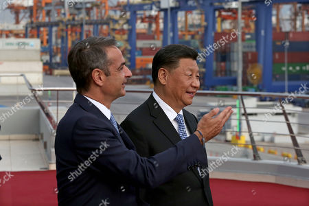 Greek Prime Minister Kyriakos Mitsotakis (L) and Chinese President Xi Jinping (R) visit the cargo terminal of Chinese company Cosco in the port of Piraeus, Greece, 11 November 2019. Chinese President Xi is on a two-day official visit to Greece.
