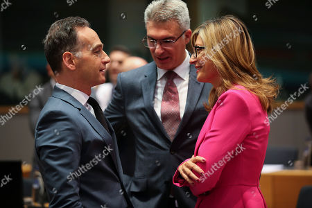 Stock Image of Heiko Maas, Carmelo Abela, Ekaterina Zaharieva. Germany's Foreign Minister Heiko Maas, left, talks to Bulgarian Foreign Minister Ekaterina Zaharieva, right, and Malta's Foreign Minister Carmelo Abela during an European Foreign Affairs Ministers meeting at the Europa building in Brussels, . European Union foreign ministers are discussing ways to keep the Iran nuclear deal intact after the Islamic Republic began enrichment work at its Fordo power plant